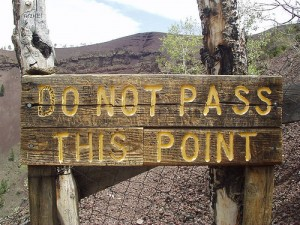 sign that says do not pass this point