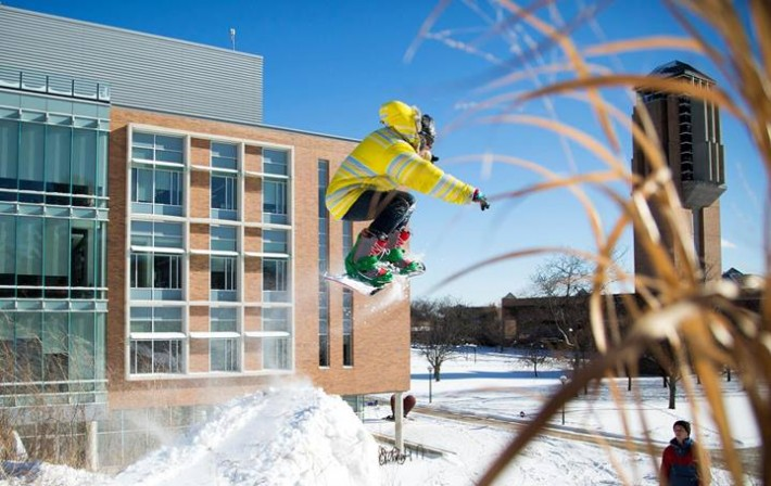 snowboarder jumping in air at umich