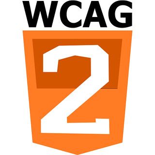 The WCAG logo. The letters WCAG on top of an orange shield with the number 2 dominating the shield.