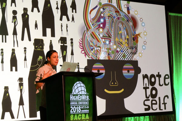 Manoush speaks to HighEdWeb with a brain-based graphic behind her