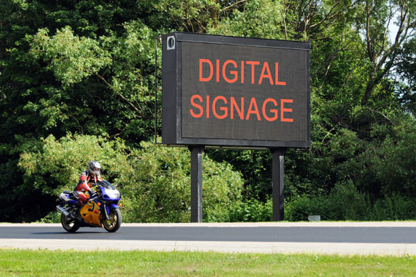 a sign that says digital signage. Whoa. Trippy.
