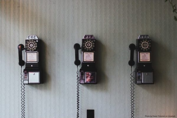 Rotary Pay Phones on a wall