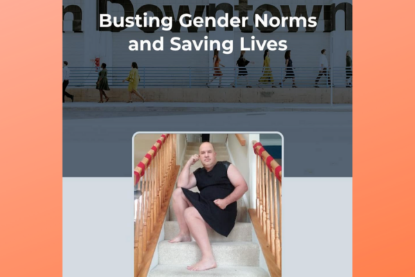 """Busting Gender Norms and Saving Lives"" Chris D'Orso sits on the stairs wearing a dress"