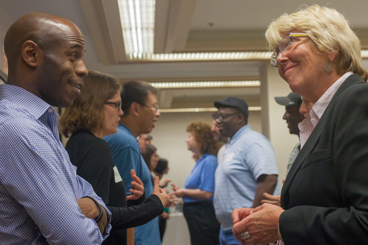Attendee conversation at the Academies