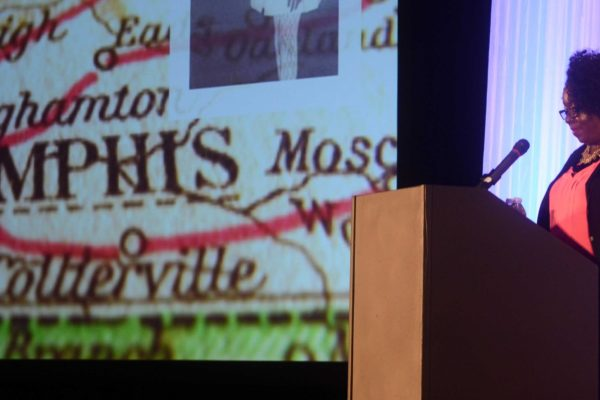 Kimberly Bryant addresses High Ed Web, with a map of memphis in the background