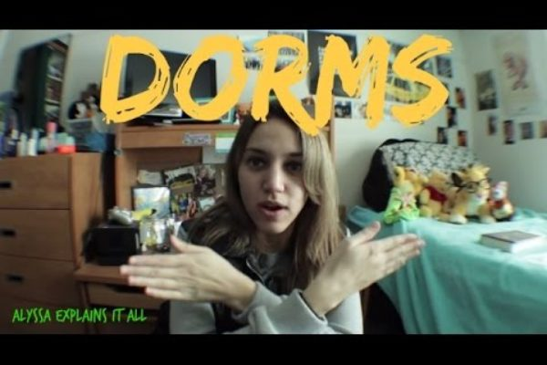 "video screen shot of alyssa pointng and word ""dorms"" overlaid"