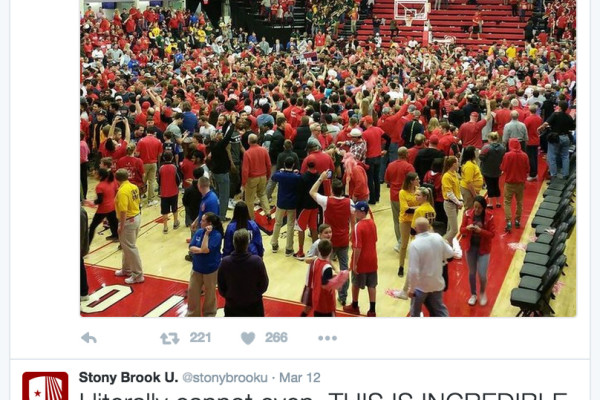 Stony Brook students rush the floor after clinching an NCAA tournament birth.
